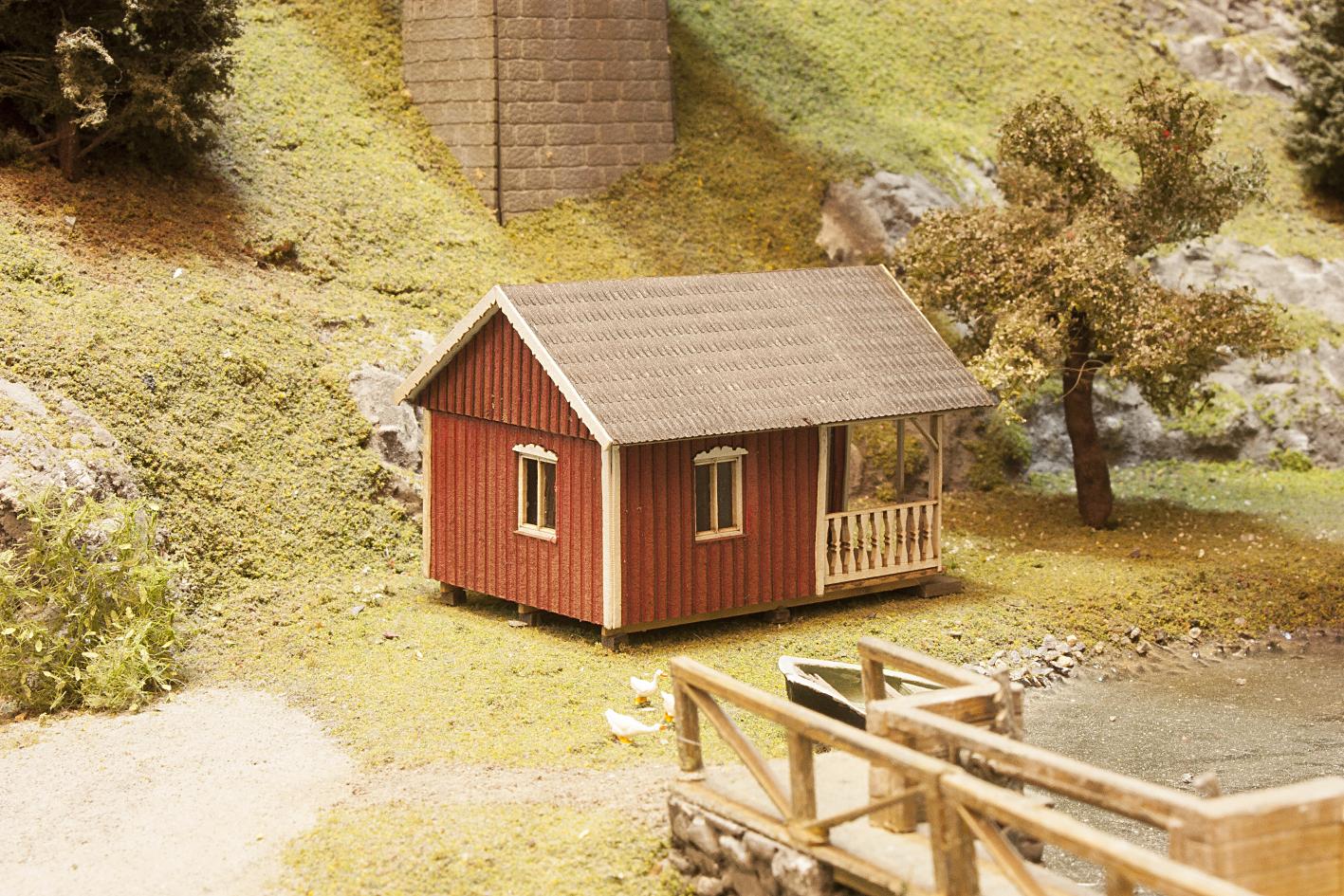 gartenhaus mit veranda schwedisch rot lasercut welten. Black Bedroom Furniture Sets. Home Design Ideas